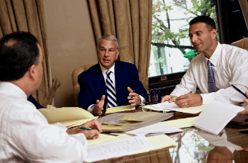 three attorneys discussing a case